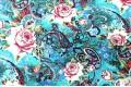 Джинсовая ткань розы в огурцах на бирюзовом фоне